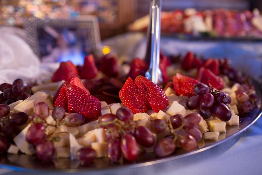 Fruit tray with strawberries, grapes and cheese