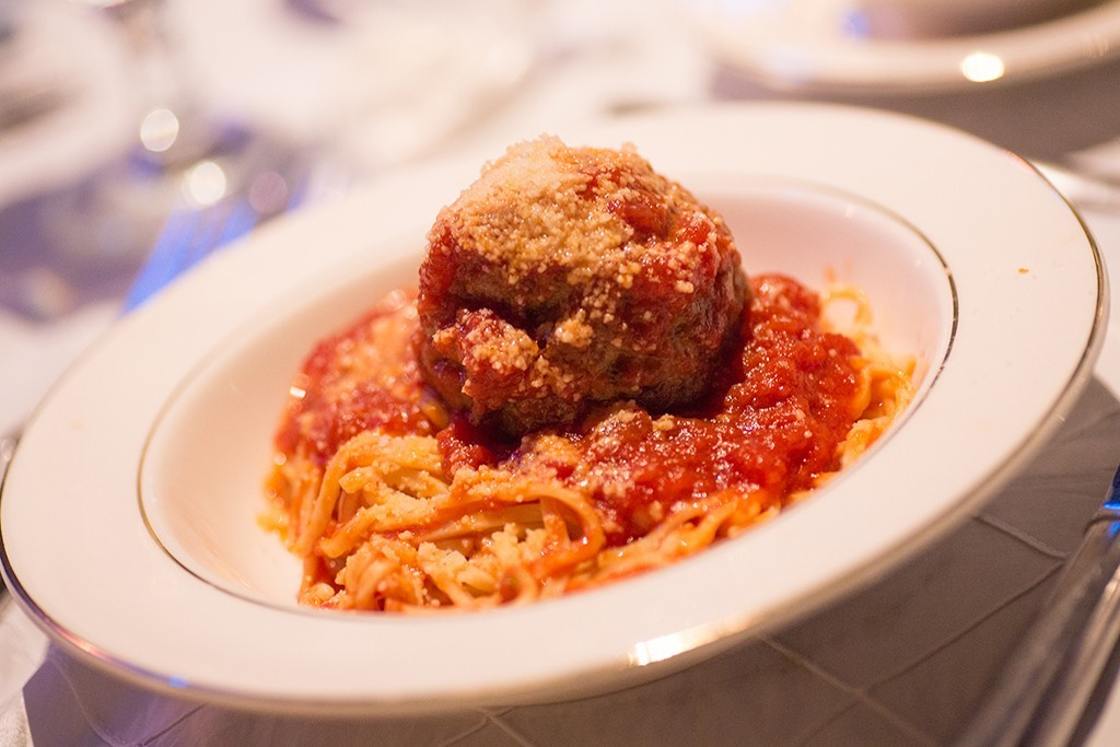 Bowl of spaghetti and a large meatball