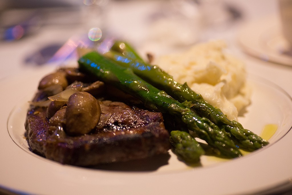 Closeup of plate with meat, potatoes and asparagus