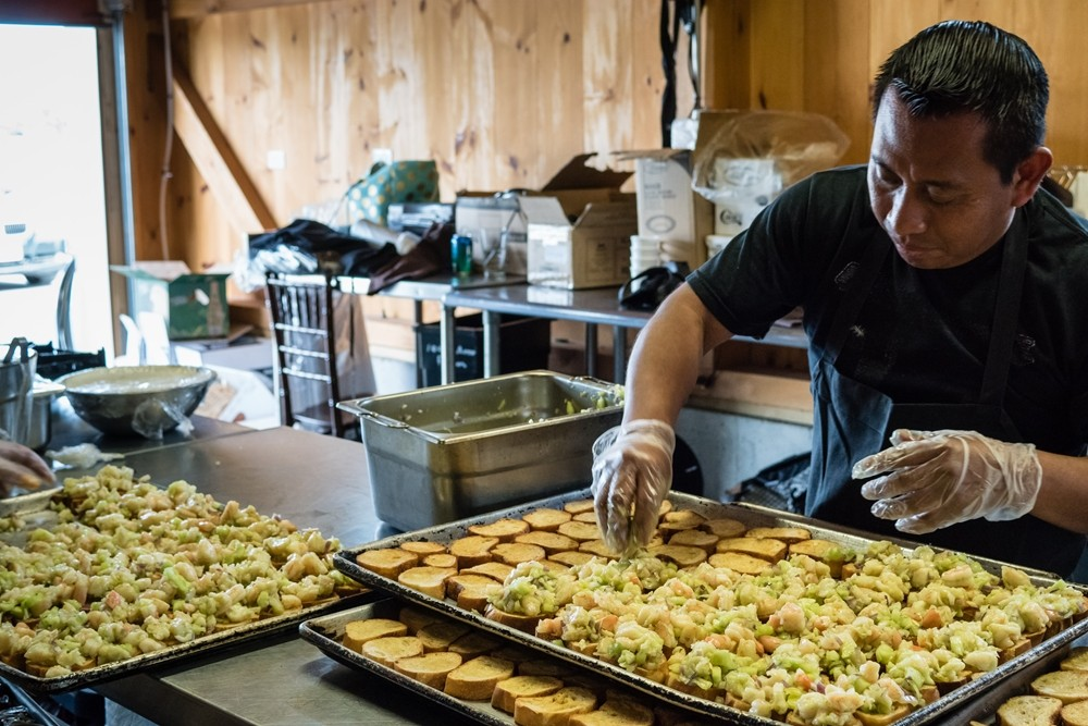 Caterer preparing trays of appetizers